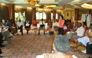 Leading a group discussion on gender and HIV/AIDS in Kenya